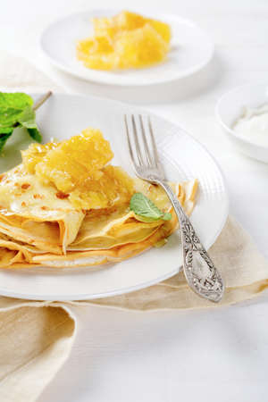 Crepe with honey and sour cream. Dessert photo