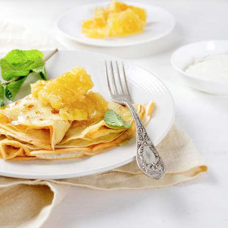 Fresh pancakes with honey for breakfast. Dessert photo