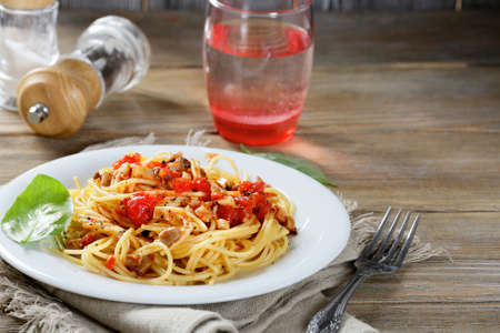 Pasta on the plate in wooden table. Traditional italian food