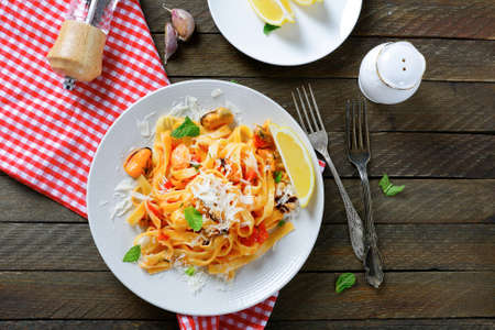 Pasta with seafood and cheese, top view