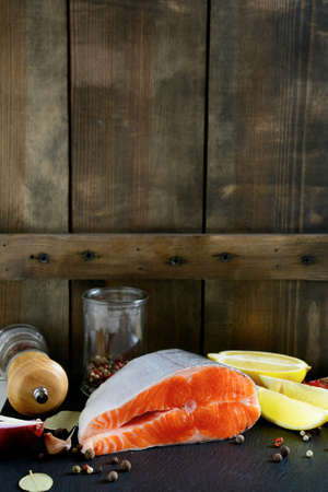 Salmon steak on wooden background. Seafood photo