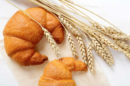 spikelets: French croissants with spikelets of wheat. Top view