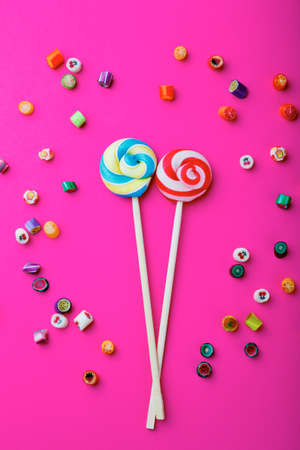 blue green background: Lollipop on a pink background. Mixed lollies Stock Photo
