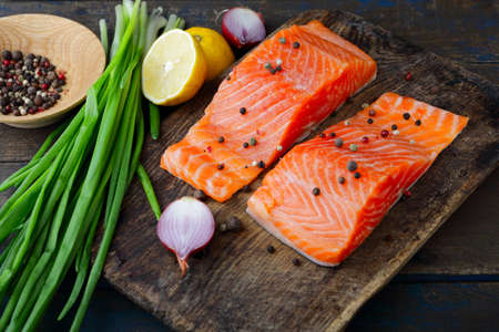 dog salmon: Red fish, onion and spice on cutting board. Seafood