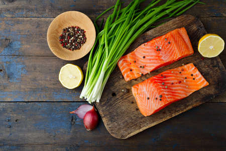 dog salmon: Salmon, onion and spice on cutting board. Red fish