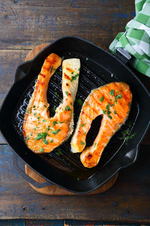 red  fish: Grilled Red Fish steak on a griddle. Top view