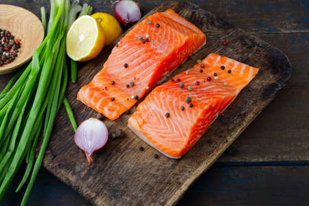dog salmon: Red fish and spice on cutting board. Salmon Stock Photo