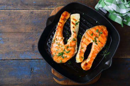 griddle: Grilled Salmon steak on a griddle. Top view Stock Photo