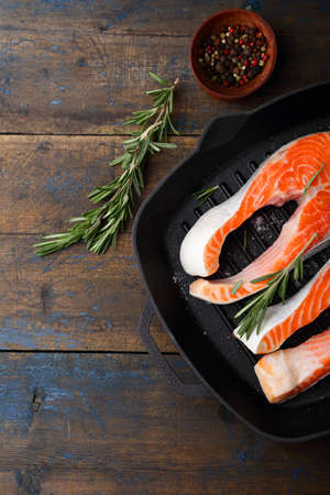 dog salmon: Raw Red Fish on a grill pan. Cooking Salmon. Top view Stock Photo