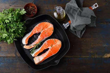 dog salmon: Salmon Steak on skillet pan. Top view