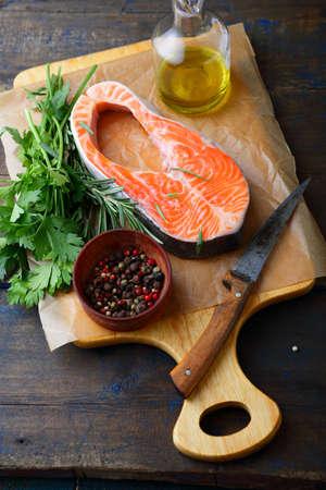 dog salmon: Steak Salmon on a cutting board. Cooking red fish