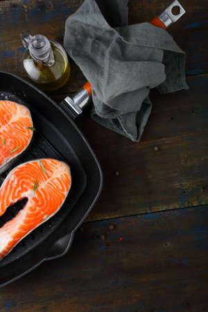 dog salmon: Raw Salmon Steak on skillet pan. Top view Stock Photo
