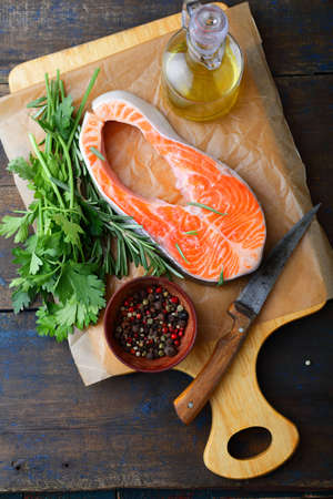 dog salmon: Cooking Red Fish. Steak Salmon on a cutting board. Top view Stock Photo