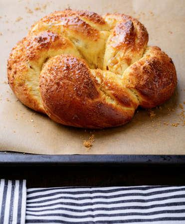 baking tray: Homemade delicious bun on baking tray. Tasty pastry