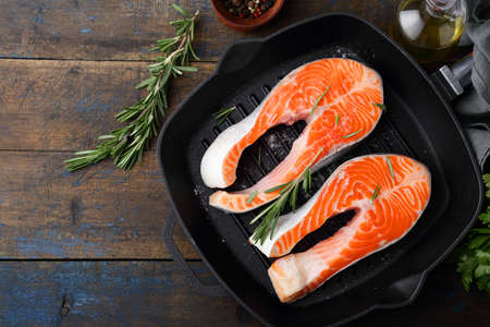 griddle: Salmon Steak on a griddle pan. Cooking Red Fish. Top view Stock Photo