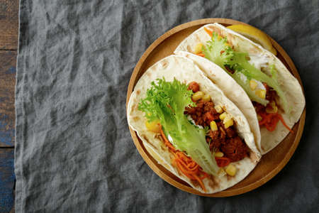 taco: Plate with two Mexican Taco and ground beef, vegetables. Top view