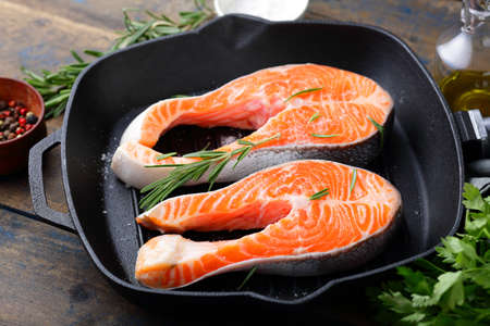 red  fish: Steak Raw Salmon on a grill pan. Cooking Red Fish Stock Photo