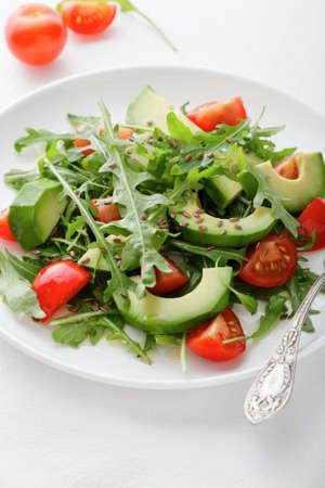 Salad with Avocado, Tomatoes and Arugula. Healthy freshness food