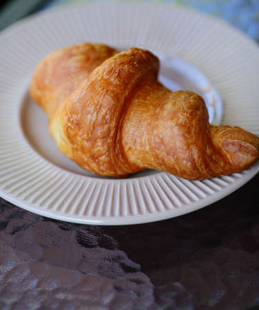 traditionally french: Croissant on a white plate. Traditional french food