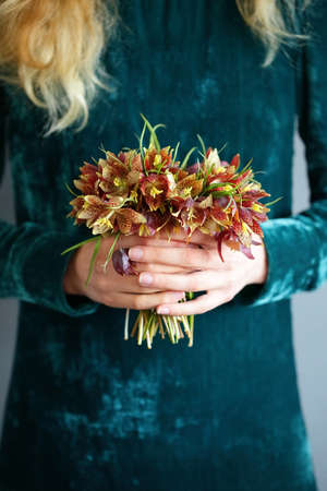 Young woman holding bouquet wild tulips. Springtime