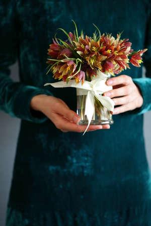 Wild flowers in the hands of women. Springtime
