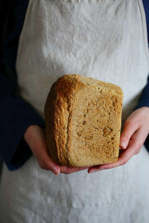 Traditional Homemade Bread in the hands of a woman baker