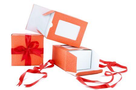 orange box with red ribbon on white background photo