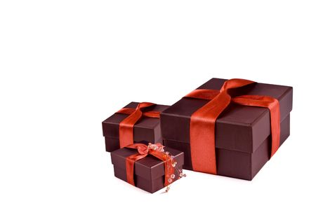 Gift box with red ribbon  on white background photo