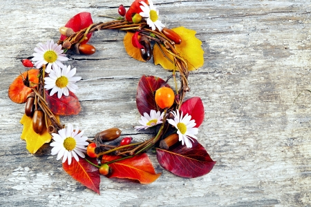 autumn  floral wreath on rustic wooden background photo