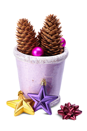 Christmas decoration (stars,pine cone, baubles, old pot)  isolated on a white background photo