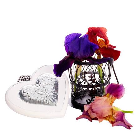 Beautiful irises with wooden heart isolated on white background  photo