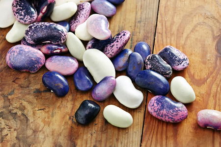 haricot: different haricot beans on the wooden table with copy space