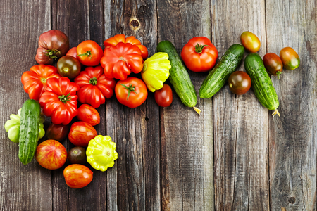 vegetables (tomatoes, cucumber) on wooden background