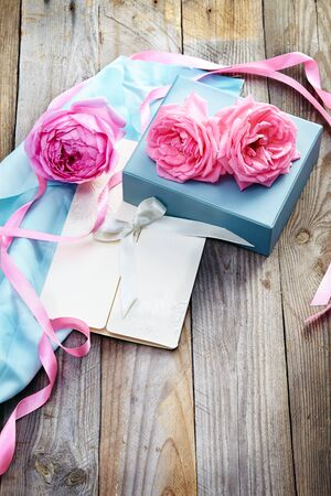 pink roses on wooden background in vintage style