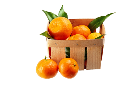 tangerines with leaves in basket isolated on white background