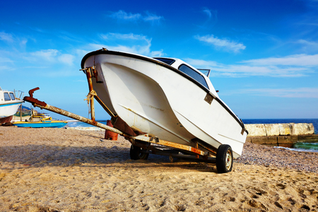 fishing boat on the beach on sunny beautiful  day, coast of Black Sea Zdjęcie Seryjne