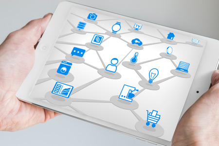 digitization: Male holding tablet in Both Hands with internet of everything IOT concept. Connected devices like sensors and smart phone.