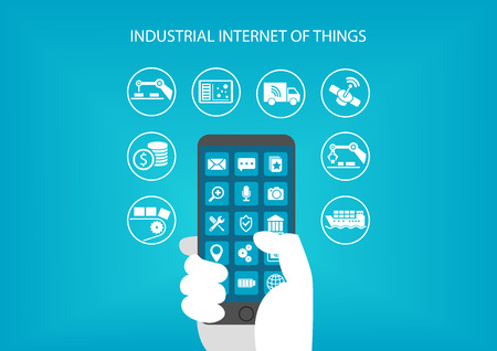 Internet des objets industriels concept. Une main tenant appareil mobile moderne comme téléphone intelligent de se connecter à différents objets et appareils