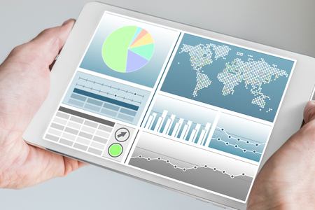 dashboard: Business man holding modern tablet with Both Hands with Business Dashboard in neutral color