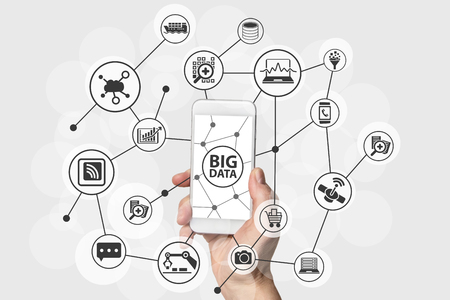 Big Data concept with hand holding modern smart phone Фото со стока