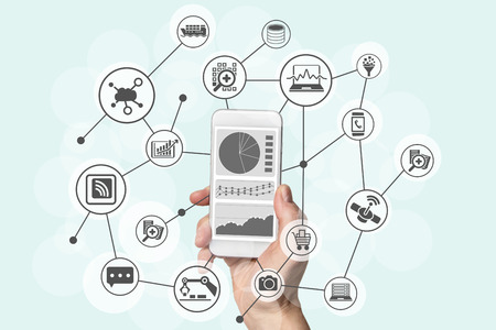 Predictive analytics and big data concept with hand holding modern smart phone to analyze data from marketing, shopping, cloud computing and mobile devices Banque d'images
