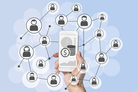 monetize: Omni and viral social marketing and mobile sales concept with hand holding modern smart phone