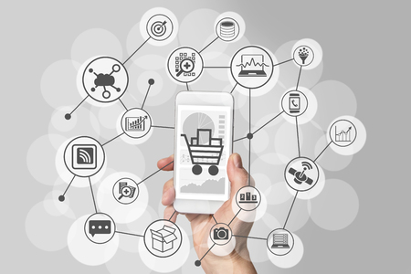 Mobile Shopping Experience with hand holding smartphone to connect to online stores to purchase consumer goods
