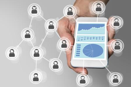 digitization: Social network Big Data analysis concept. Hand holding modern smart phone.