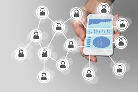 monetize: Social network Big Data analysis concept. Hand holding modern smart phone.