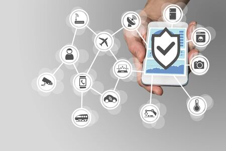shielding: Hand holding modern smart phone on neutral background. Security for Internet of Things concept to secure mobile devices