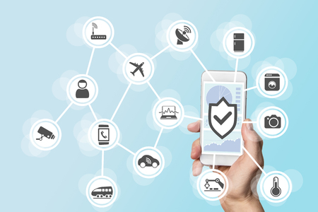 artificial model: Internet of things security concept with hand holding modern smart phone to control intruders into a network of objects