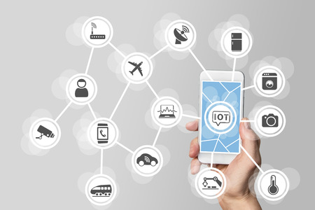 Internet of things IOT concept illustrated by modern smartphone Stockfoto