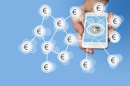 batch of euro: Mobile e-payment and e-commerce concept with hand holding modern smartphone in front of neutral blue background