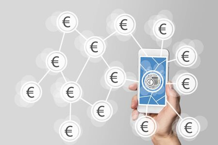 batch of euro: Mobile e-payment and e-commerce concept with hand holding modern smartphone in front of neutral gray background